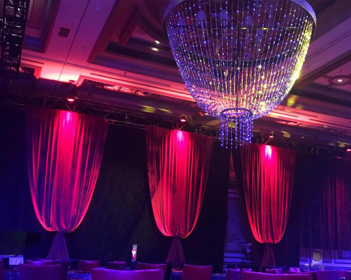 Red Bellowed Velour Velvet Drapery with a Hanging Beaded Chandelier from Turn of Events Las Vegas
