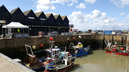Whitstable Harbour and whelk stores in the background