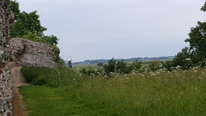 Burgh Castle Roman fort with windmills in the distance