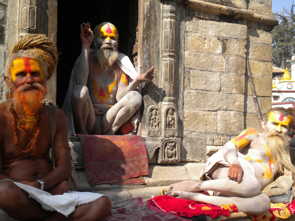 Holy men greet tourists at Pashupatinath Temple.