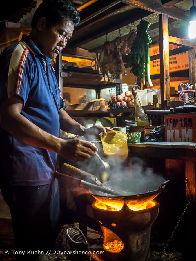 Roadside food vendor cooking up some noodles in Yogyakarta