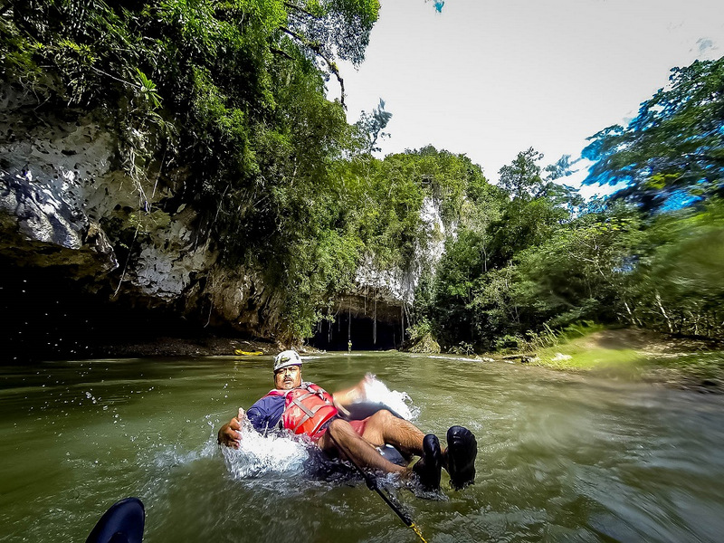 While there's something to be said for the relaxation of sitting on a beach with a fruity beverage, we also enjoy our more active excursions. In this shot, you can just feel the heat and humidity of the jungle being washed away as you plunge into the cool river waters of Belize.