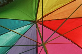 A colorful umbrella kept attendees cool while celebrating the many different members of the LGBTQ community.