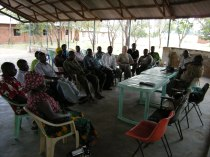 Community leaders in Ulyankulu, Tanzania, gather to speak with a visitor.