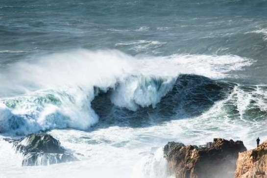 wave hits rock