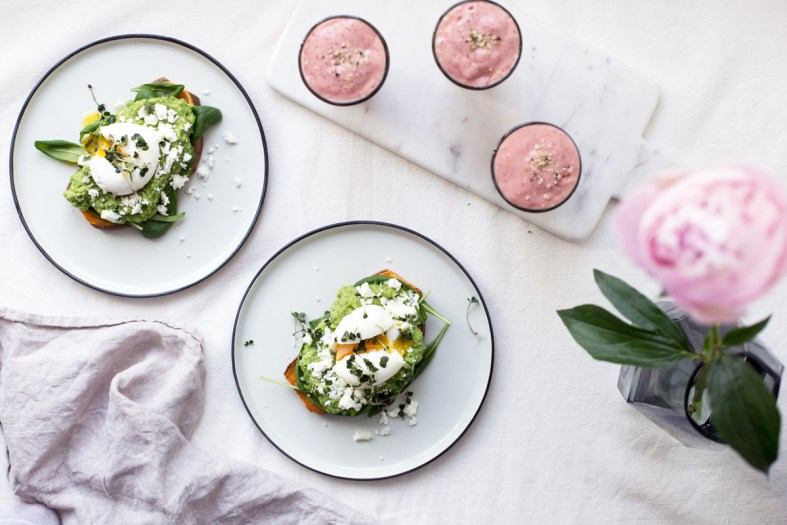 Sweet Potato Toasts w/ Avocado Pea Mash, Feta & Eggs