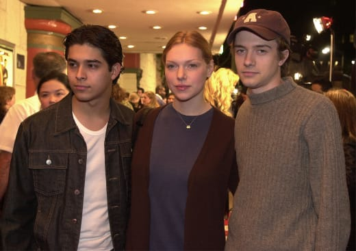 Actors Wilmer Valderrama, left, Laura Prepon, and Topher Grace