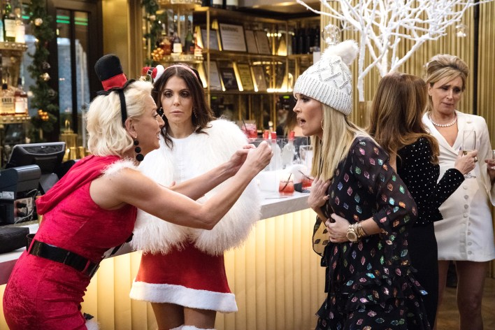 Dorinda Medley, Bethenny Frankel, and Tinsley Mortimer at a Christmas party on Bravo's Real Housewives of New York City.