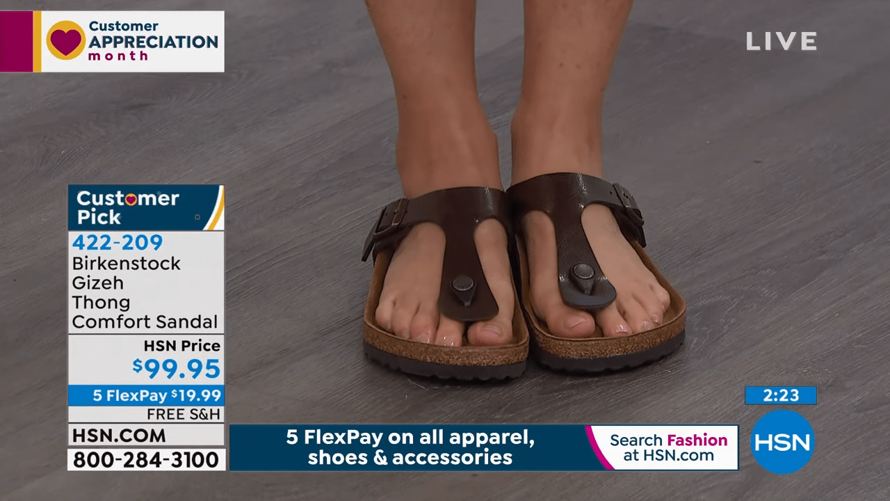 Feet of HSN show host Sarah Anderson in Birkenstock thong sandals.