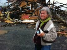 Mary Hazelbaker in front of what's left of her Joplin home
