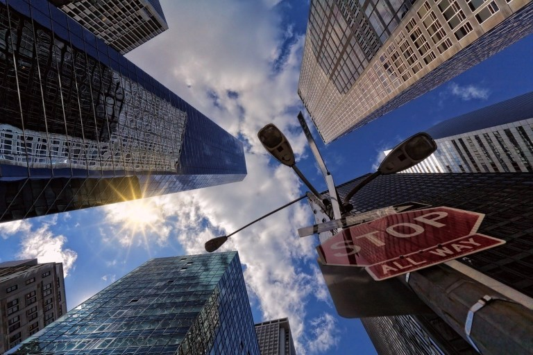 looking up at sky and tall buildings