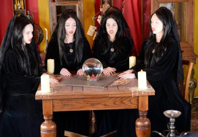 The Four Who Speak as One, who are shrouded in black, on Sleepy Hollow