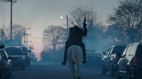 The Headless Horseman rides through the streets on Sleepy Hollow.