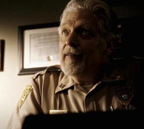 Sheriff August Corbin (Clancy Brown) sits in his office on Sleepy Hollow TV.