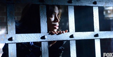 Abbie peers out through prison bars on Sleepy Hollow