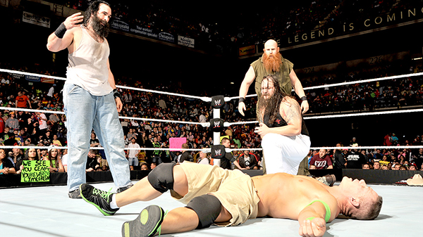 The Wyatt Family stands over a fallen John Cena. Photo Credit: WWE