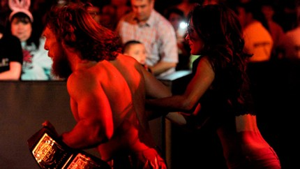 Daniel Bryan and Brie Bella-Bryan flee Kane. Photo credit: WWE
