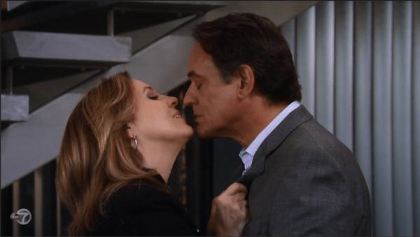 Laura gives Kevin a kiss goodbye.