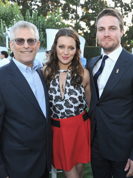 (L-R) President of The CW Television Network Mark Pedowitz and actors Katie Cassidy and Stephen Amell attend the CW, CBS And Showtime 2012 Summer TCA party held at The Beverly Hilton Hotel on July 29, 2012 in Beverly Hills, California.