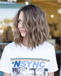 3 short wavy hairstyle with pretty light brown color source pophaircuts.com