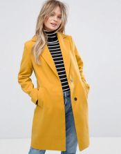 Playful chic in yellow outerwear
