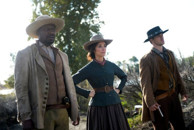 "TIMELESS -- ""The Alamo"" Episode 104 -- Pictured: (l-r) Malcolm Barrett as Rufus Carlin, Abigail Spencer as Lucy Preston, Matt Lanter as Wyatt Logan -- (Photo by: Sergei Bachlakov/NBC)"