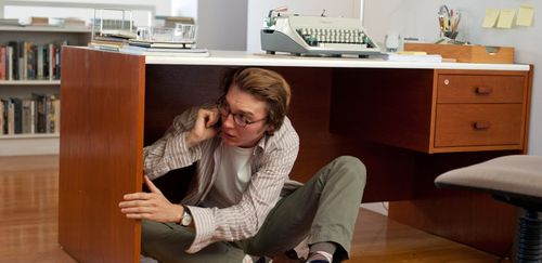 Why is this guy under his desk? He's got a damn Selectric, for chrissakes!