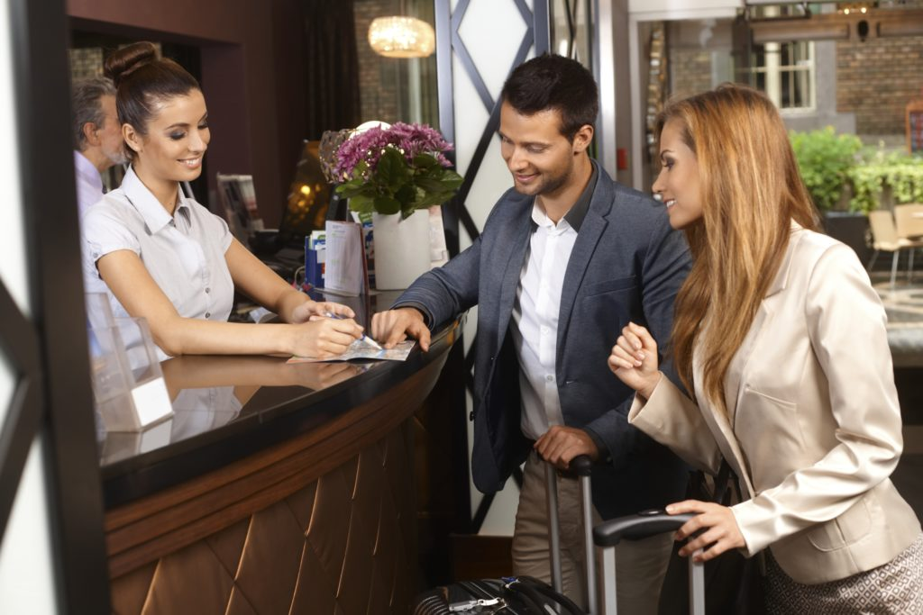 picture of hotel check in with couple before paper attack