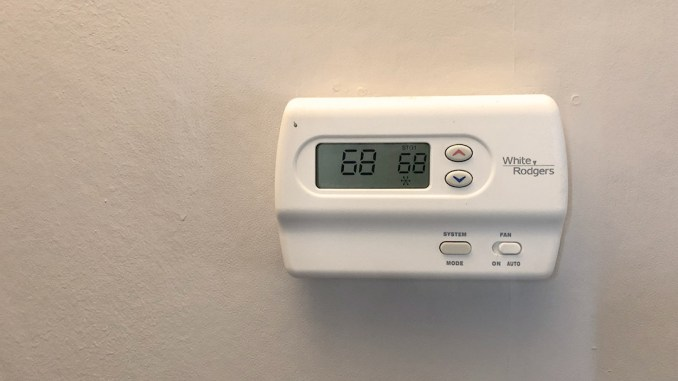 White Thermostat Tan Background Twat News