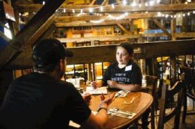 Alexis Templeton, right, speaks with a mentor, Marcus Eldridge, during the Summer Songwriters Experience Camp Monday at Dosey Doe's Big Barn.