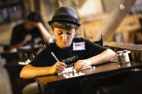 Houston Wyrick, a student of the Summer Songwriters Experience Camp, brainstorms song lyrics Monday at Dosey Doe's Big Barn.