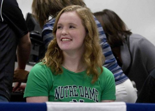Claire Andrews signed her letter of intent to dive for Notre Dame during a college signing celebration for atheltes at College Park High School Wednesday.