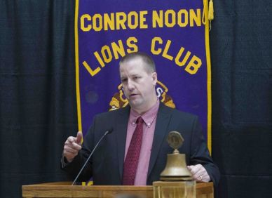 The Woodlands coach Dale Reed Willis speaks about the upcoming basketball season at the Conroe Noon Lions Club meeting Wednesday.