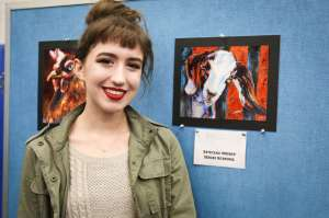 College Park student Olivia Rominger poses for a portrait with a photo of her special merit artwork during the Conroe ISD Western Art Show on Saturday, Jan. 7, 2017, at Oak Ridge 9th Grade Campus.