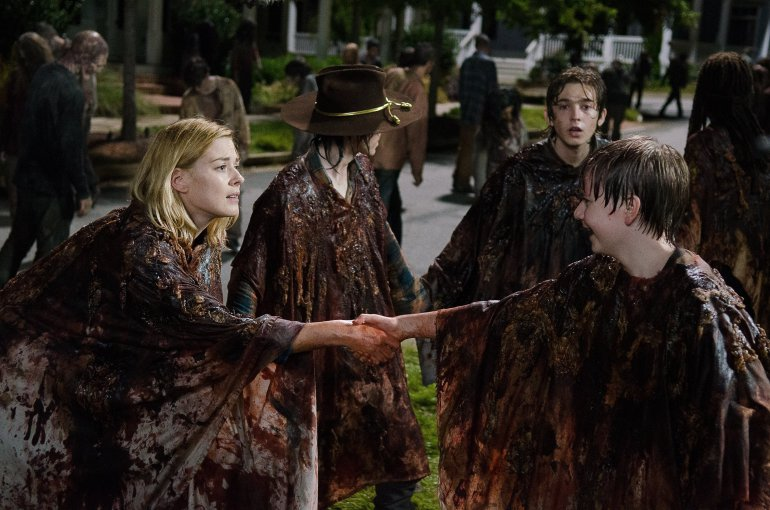 Chandler Riggs as Carl Grimes, Alexandra Breckenridge as Jessie Anderson, and Austin Abrams as Ron in season 6 of The Walking Dead.