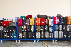 Lots of suitcases at airport ready to be put on plane