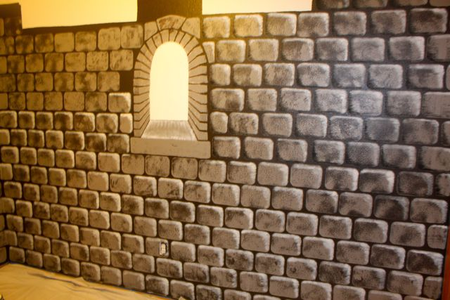 Faux castle wall with window, and one side not yet highlighted