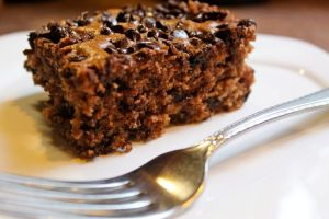 Slice of chocolate chip oatmeal snackin' cake with a fork