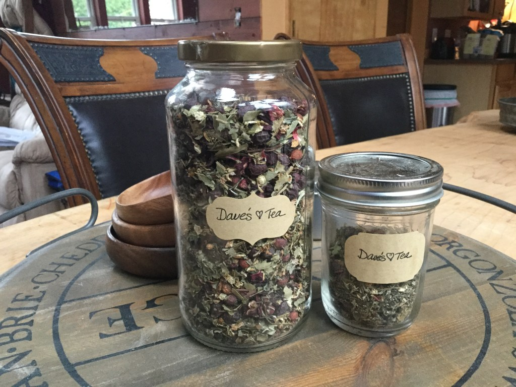 Two jars of an herbal blend sitting on a table