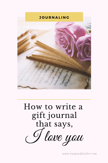 An open journal with pink roses sitting on top