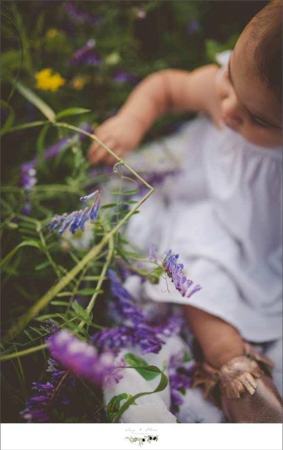 purple flower, white dress, greenery, baby