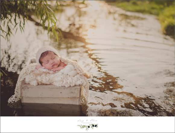 shimmering rippling water with bundled newborn