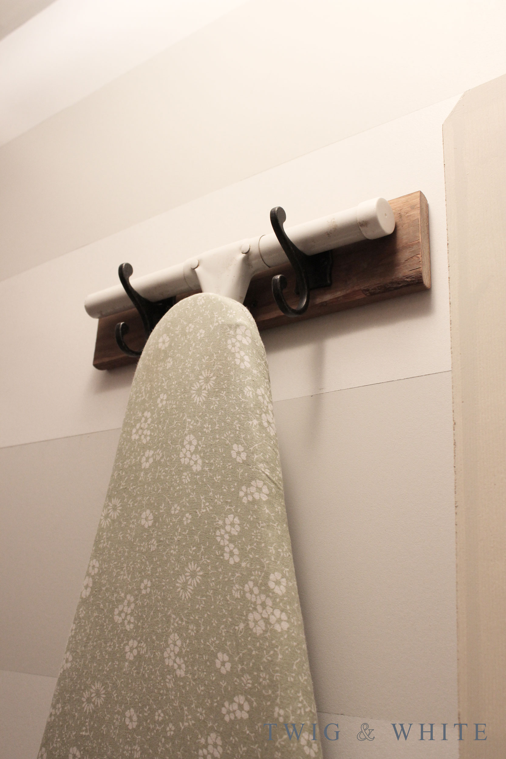 diy ironing board hanger with hooks for laundry room