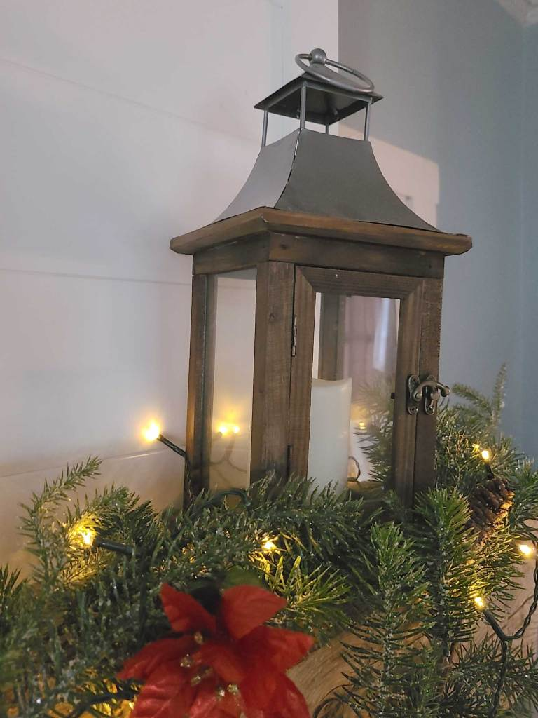 chrismtas mantle with rustic lantern