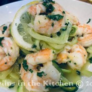 Plate your zoodles then top with shrimp & scampi sauce, garnish with lemon slice