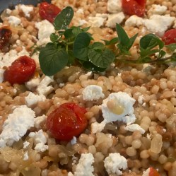 Feta cheese & tomatoes added to couscous