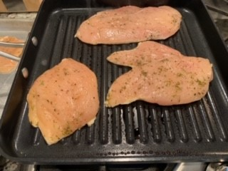 Marinated Chicken breasts in grill pan