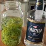 Cover flowers with Everclear 151 grain alcohol