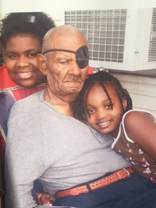A picture of my grandfather and two of my little cousins.