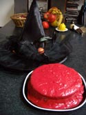 a bloody mess of a cake and a witches hat
